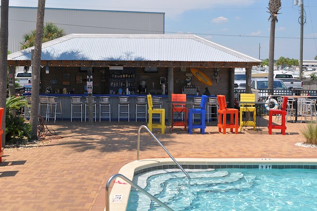 Relax at our Poolside Tiki Bar.